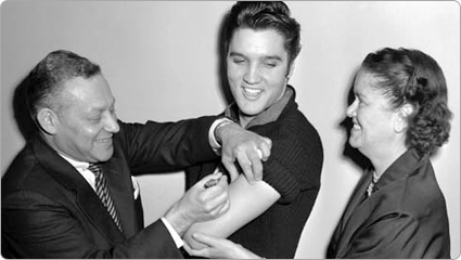 Elvis Presley receives his polio inoculation to promote vaccination; 1956