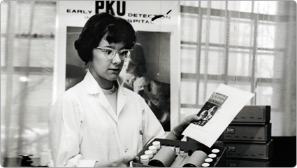 Lab assistant assembles PKU early detection kits; 1963